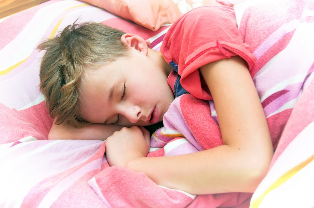 What should I do if my child is wetting the bed?